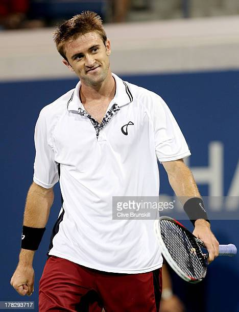 Tim Smyczek of the United States celebrates match point against James Duckworth of Australia in their men's singles first round match on Day Three of...