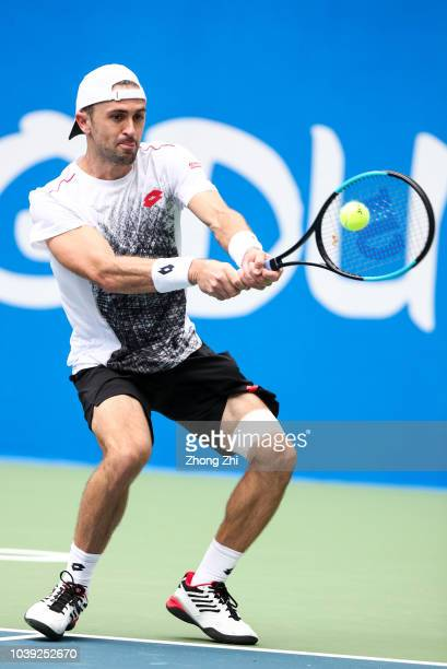 Tim Smyczek of the United States returns a shot against Joao Sousa of Portugal during 2018 ATP Chengdu Open at Sichuan International Tennis Centre on...