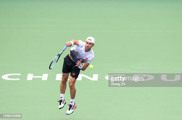 Tim Smyczek of the United States serves against Joao Sousa of Portugal during 2018 ATP Chengdu Open at Sichuan International Tennis Centre on...