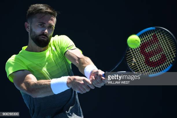 Tim Smyczek of the US hits a return during their men's singles second round match against Spain's Albert RamosVinolas on day four of the Australian...