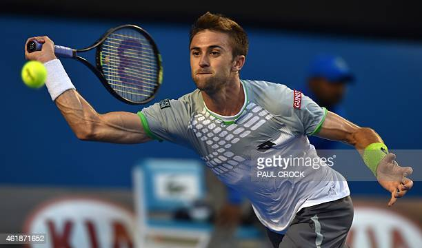 Tim Smyczek of the US plays a shot during his men's singles match against Spain's Rafael Nadal on day three of the 2015 Australian Open tennis...