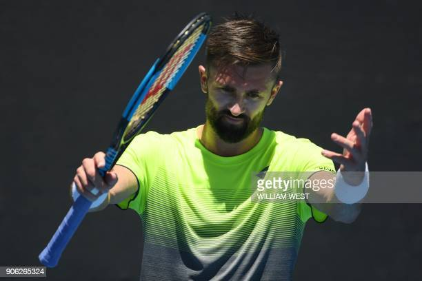 Tim Smyczek of the US reacts during their men's singles second round match against Spain's Albert RamosVinolas on day four of the Australian Open...