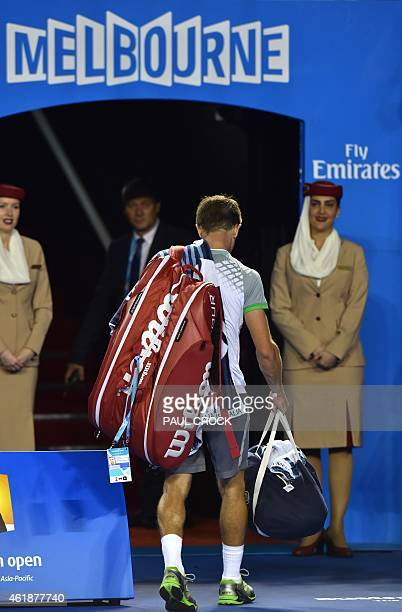 Tim Smyczek of the US walks off court after defeat in his men's singles match against Spain's Rafael Nadal on day three of the 2015 Australian Open...