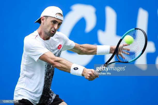 Tim Smyczek of United States in action against Joao Sousa of Portugal during ATP World Tour Chengdu Open 1st Round at Sichuan International Tennis...