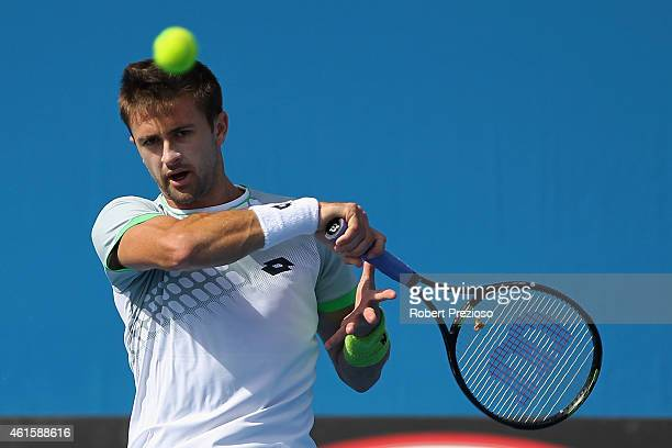 Tim Smyczek of USA plays a forehand in his qualifying match against Marc Polmans of Australia for 2015 Australian Open at Melbourne Park on January...