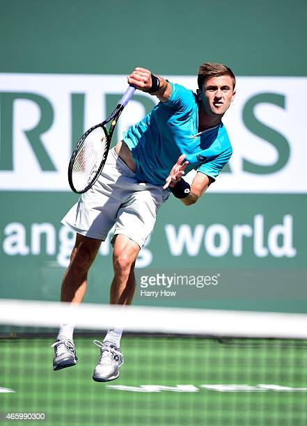 Tim Smyczek serves in his match against Benjamin Becker of Germany during the BNP Parisbas Open at the Indian Wells Tennis Garden on March 11, 2015...