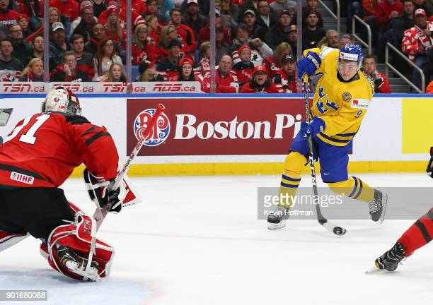 Tim Soderlund of Sweden scores a short handed goal on Carter Hart of Canada in the second period during the Gold medal game of the IIHF World Junior...