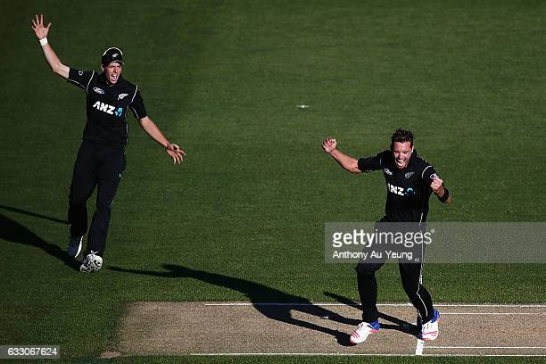 Tim Southee and Mitchell Santner of New Zealand celebrate after winning the first One Day International game between New Zealand and Australia at...