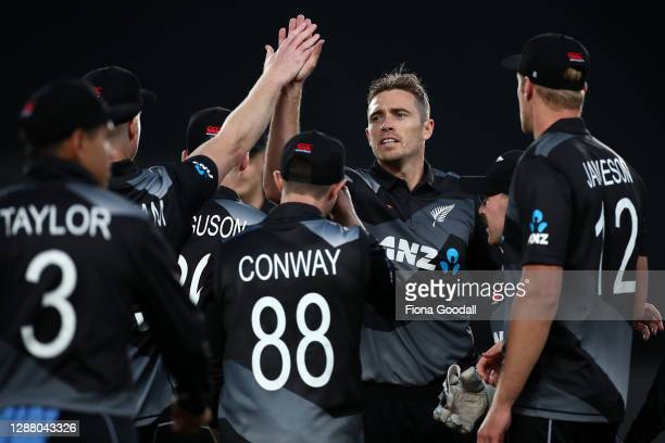 Tim Southee, captain of New Zealand celebrates a wicket with the team during game one of the International T20 series between New Zealand and the...