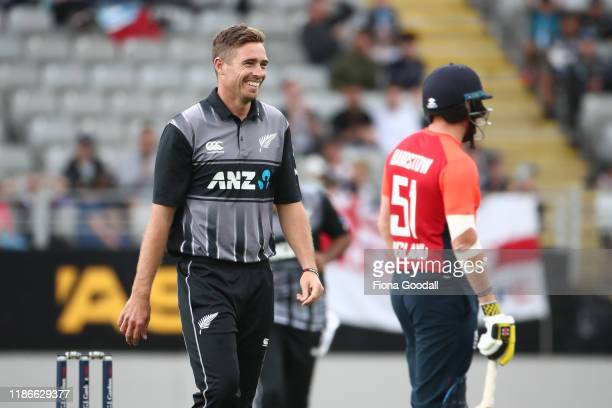Tim Southee captain of New Zealand takes a wicket during game five of the Twenty20 International series between New Zealand and England at Eden Park...