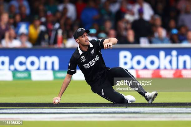 Tim Southee of New Zealand catches out Jos Buttler of England during the Final of the ICC Cricket World Cup 2019 between New Zealand and England at...