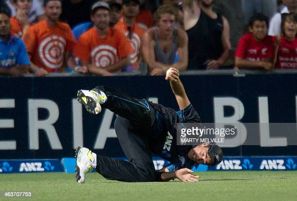 Tim Southee of New Zealand catches out Suresh Raina of India during the first international one day cricket match between New Zealand and India in...