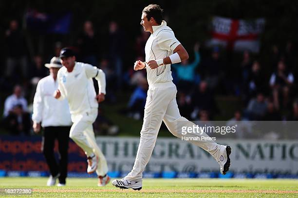 Tim Southee of New Zealand celebrates after bowling Nick Compton of England out during day two of the First Test match between New Zealand and...