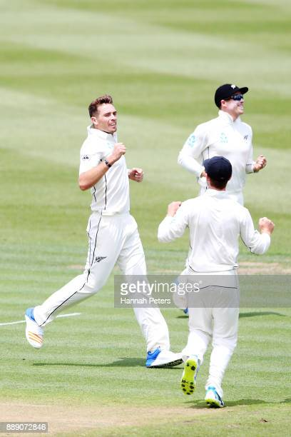 Tim Southee of New Zealand celebrates after claiming the wicket of Kieran Powell of the West Indies during day two of the Second Test Match between...