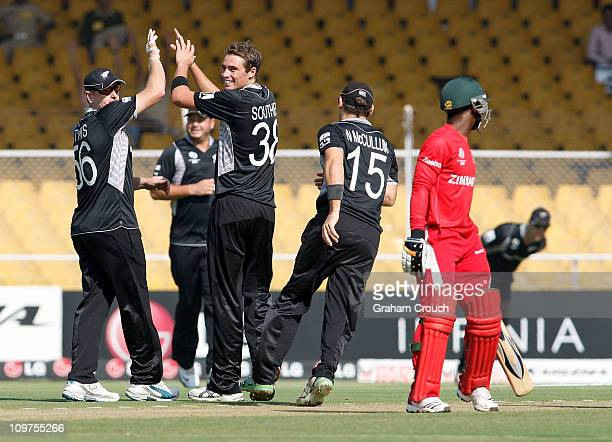 Tim Southee of New Zealand celebrates after getting the wicket of Taitenda Taibu of Zimbabwe in the 2011 ICC World Cup Group A match between New...