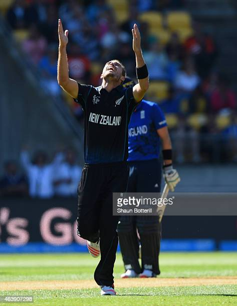 Tim Southee of New Zealand celebrates after taking a wicket of Steven Finn of England during the 2015 ICC Cricket World Cup match between England and...
