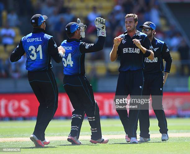 Tim Southee of New Zealand celebrates after taking the wicket of Ian Bell of England during the 2015 ICC Cricket World Cup match between England and...