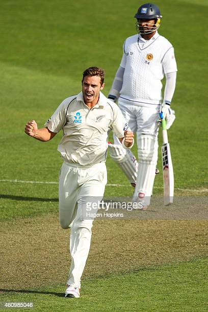 Tim Southee of New Zealand celebrates after taking the wicket of Angelo Mathews of Sri Lanka while Kumar Sangakkara looks on during day one of the...