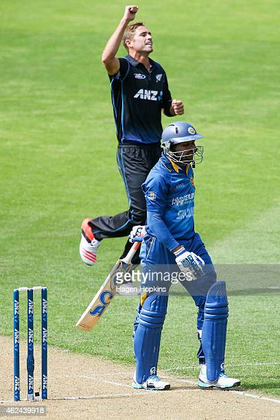 Tim Southee of New Zealand celebrates after taking the wicket of Tillakaratne Dilshan of Sri Lanka during the One Day International match between New...