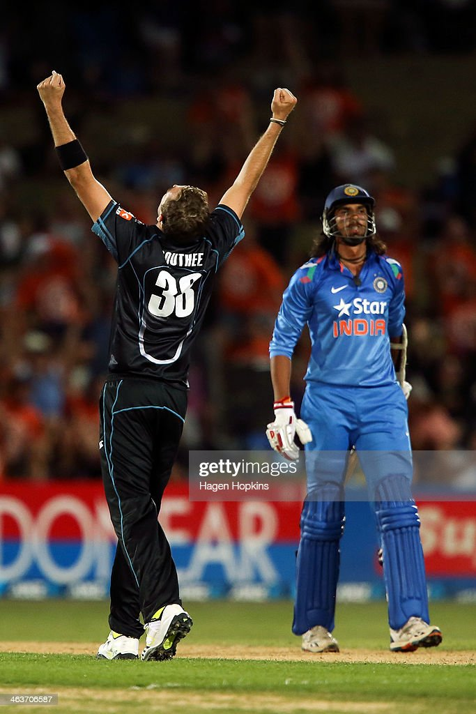 Tim Southee of New Zealand celebrates after taking the wicket of Ishant Sharma of India during the first One Day International match between New Zealand and India at McLean Park on January 19, 2014 in Napier, New Zealand.