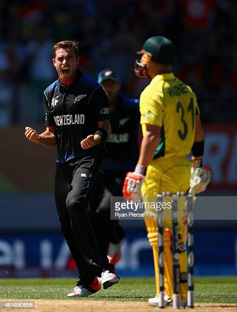 Tim Southee of New Zealand celebrates after taking the wicket of David Warner of Australia during the 2015 ICC Cricket World Cup match between...