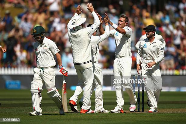 Tim Southee of New Zealand celebrates after taking the wicket of David Warner of Australia during day one of the Test match between New Zealand and...