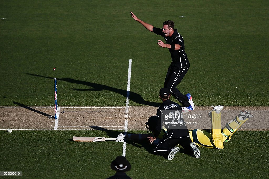 Tim Southee of New Zealand celebrates as teammate Kane Williamson dismisses Josh Hazlewood of Australia on a run out to win the first One Day International game between New Zealand and Australia at Eden Park on January 30, 2017 in Auckland, New Zealand.
