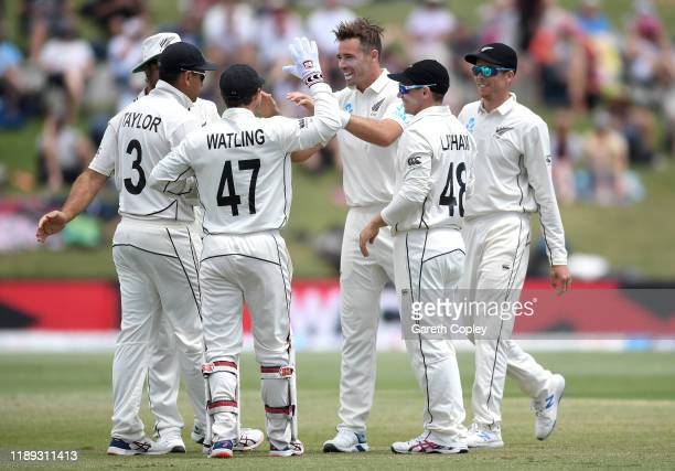 Tim Southee of New Zealand celebrates dismissing Ben Stokes of England during day two of the first Test match between New Zealand and England at Bay...