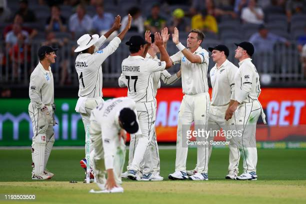 Tim Southee of New Zealand celebrates dismissing Matthew Wade of Australia during day one of the First Test match between Australia and New Zealand...