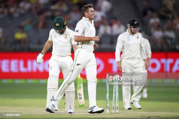Tim Southee of New Zealand celebrates dismissing Tim Paine of Australia during day three of the First Test match in the series between Australia and...