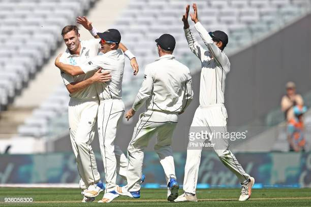 Tim Southee of New Zealand celebrates his caught and bowled of Jonny Bairstow of England during day one of the First Test match between New Zealand...