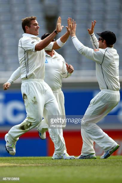 Tim Southee of New Zealand celebrates his wicket of Cheteshwar Pujara of India during day four of the First Test match between New Zealand and India...