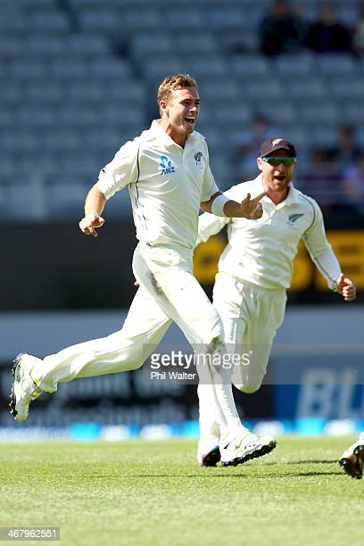 Tim Southee of New Zealand celebrates his wicket of Rohit Sharma of India during day four of the First Test match between New Zealand and India at...