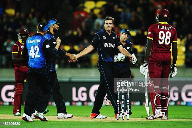 Tim Southee of New Zealand celebrates the wicket of Jerome Taylor of West Indies during the 2015 ICC Cricket World Cup match between New Zealand and...