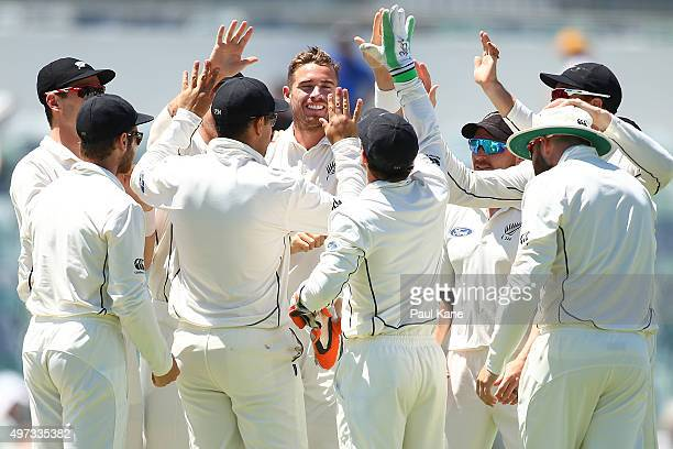 Tim Southee of New Zealand celebrates the wicket of Joe Burns of Australia with team mates during day four of the second Test match between Australia...