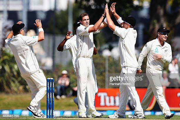 Tim Southee of New Zealand celebrates the wicket of Marlon Samuels of the West Indies during day three of the first test match between New Zealand...