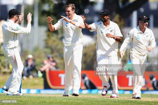 Tim Southee of New Zealand celebrates the wicket of Narsingh Deonarine of the West Indies with Aaron Redmond Ish Sodhi and Brendon McCullum during...