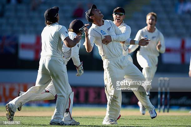 Tim Southee of New Zealand celebrates with Brendon McCullum after catching out Steven Finn of England during day four of the Third Test match between...