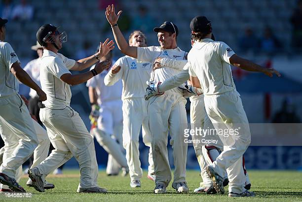 Tim Southee of New Zealand celebrates with teammates after catching out Steven Finn of England during day four of the Third Test match between New...