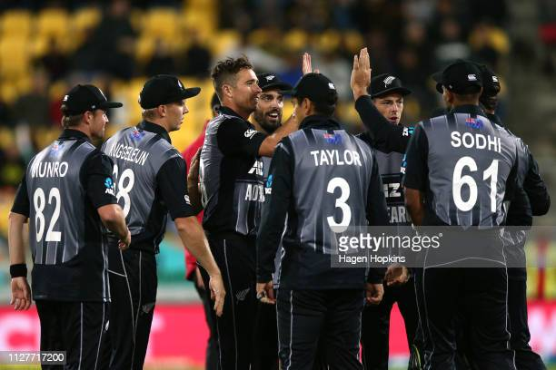 Tim Southee of New Zealand celebrates with teammates after taking the wicket of Rohit Sharma of India during game one of the International T20 Series...