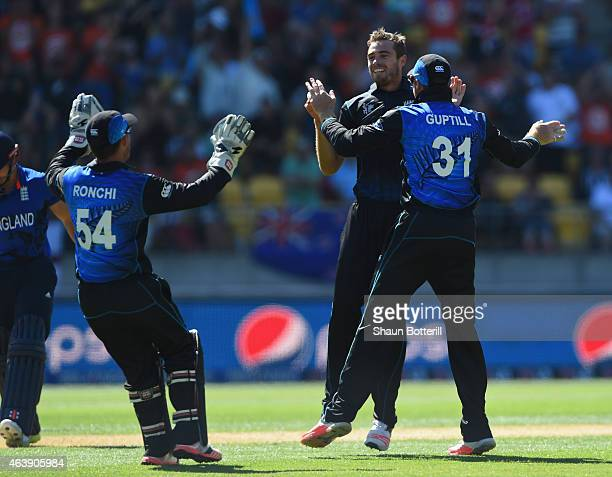 Tim Southee of New Zealand celebrates with teammates after taking the wicket of James Taylor of England during the 2015 ICC Cricket World Cup match...