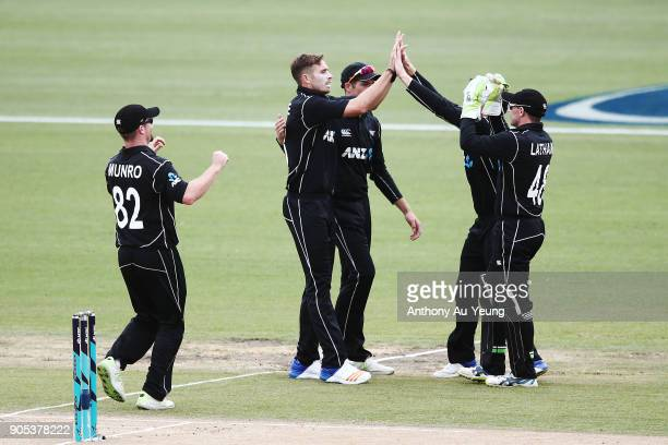 Tim Southee of New Zealand celebrates with teammates for the wicket of Babar Azam of Pakistan during game four of the One Day International Series...