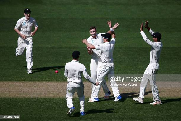 Tim Southee of New Zealand celebrates with teammates for the wicket of Jonny Bairstow of England during day one of the First Test match between New...