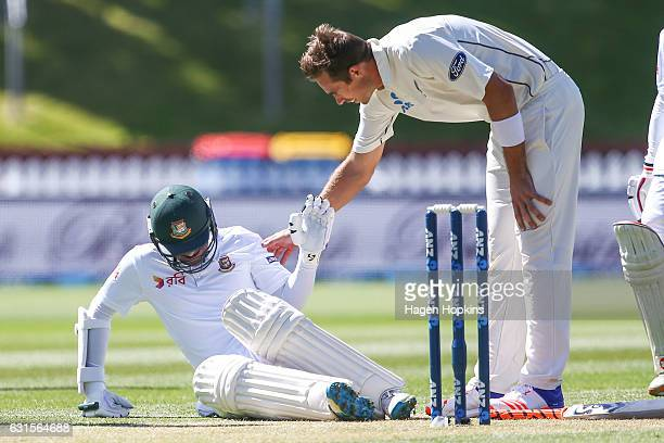 Tim Southee of New Zealand checks on the health of Shakib Al Hasan of Bangladesh after striking him with the ball during day two of the First Test...