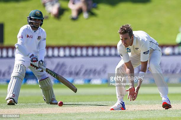 Tim Southee of New Zealand fields off his own bowling during day two of the First Test match between New Zealand and Bangladesh at Basin Reserve on...