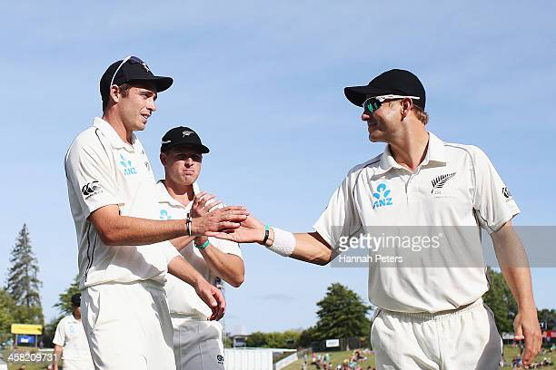 Tim Southee of New Zealand is congratulated by Neil Wagner after claiming his 100th test wicket during day three of the Third Test match between New...