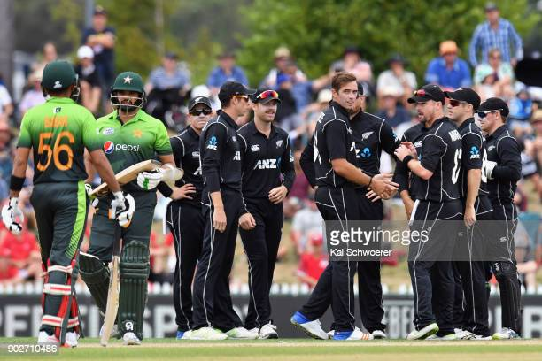Tim Southee of New Zealand is congratulated by team mates after dismissing Azhar Ali of Pakistan during the second match in the One Day International...