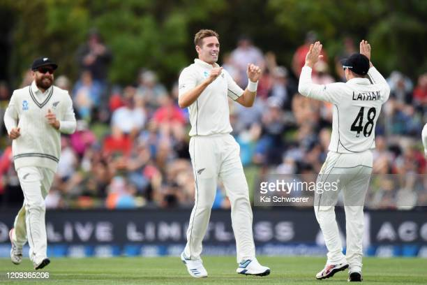 Tim Southee of New Zealand is congratulated by team mates after dismissing Virat Kohli of India during day one of the Second Test match between New...