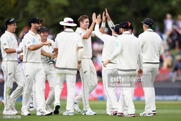 Tim Southee of New Zealand is congratulated by team mates after dismissing Ajinkya Rahane of India during day one of the Second Test match between...