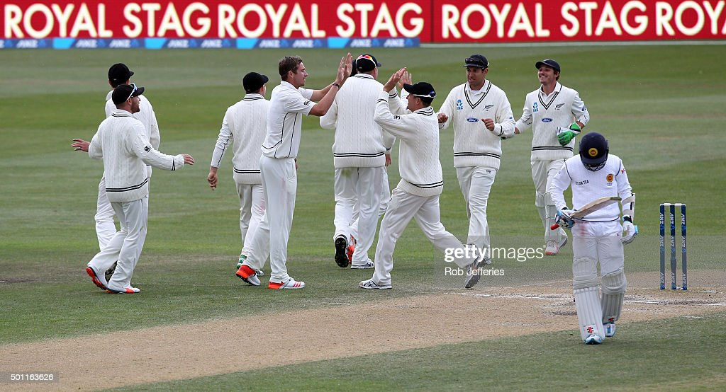 Tim Southee of New Zealand is congratulated on the dismissal of Kusal Mendis of Sri Lanka by his team-mates during day four of the First Test match between New Zealand and Sri Lanka at University Oval on December 13, 2015 in Dunedin, New Zealand.